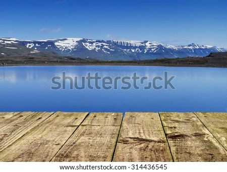 Panoramic view to mountain lake in Banff national park,Canada with wooden pier - stock photo