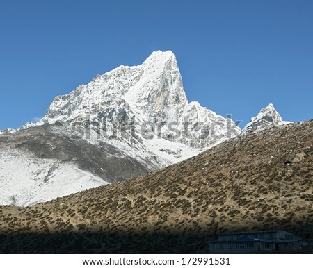 Panoramic view to the peak Tabuche from the village of Dingboche in the valley of Chukung district Everest - Nepal, Himalayas - stock photo