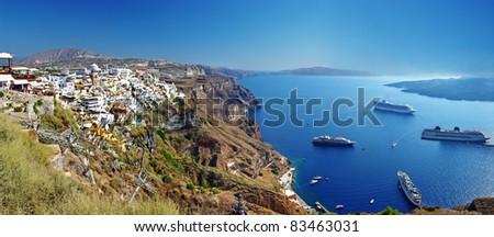 panoramic view with cruise boats - Santorini - stock photo