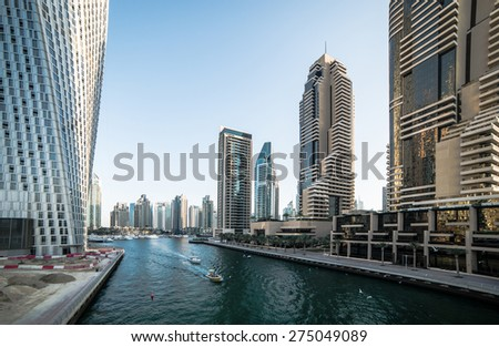 Panoramic view with modern skyscrapers and water channel of Dubai Marina, United Arab Emirates - stock photo