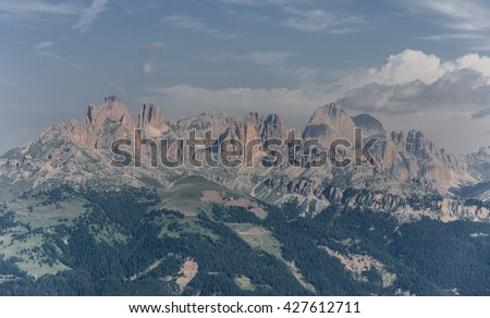 Panoramic views of the entire Catinaccio/Rosengarten mountain massif as seen from Buffaure mountain, above Fassa valley and Pozza di Fassa village, Dolomites, Trentino, Alto Adige, South Tyrol, Italy