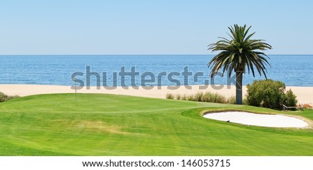 Panoramic views of the golf course to the sea and palm trees. Portugal, Algarve. - stock photo