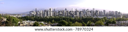 Panoramic water view of Vancouver from false creek. There is a light early morning mist.The roof is being built on B.C.Place. - stock photo