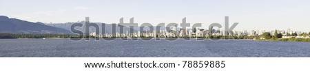 Panoramic water view of Vancouver.Stanley Park on the right side - stock photo
