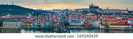 Panoramic winter view of Prague from The Old Town Tower on the Charles Bridge on the sunset - stock photo