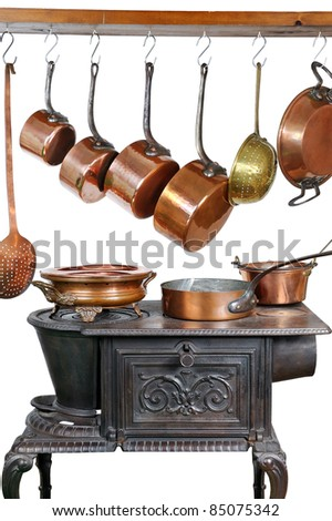 pans and kitchen utensils in copper - stock photo
