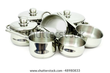 Pans made of stainless steel on a white background - stock photo