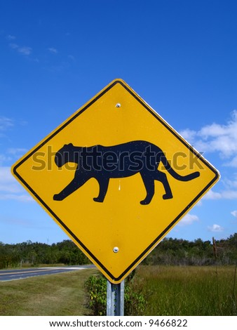 Panther-crossing road sign in Florida Everglades National Park. - stock photo