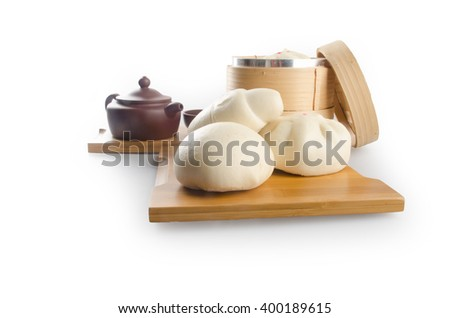 pao or dim sum in bamboo steamer with chinese bun - stock photo