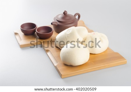 pao or mantou chinese steamed bun on a background - stock photo
