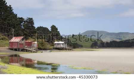 Papanui Inlet boat houses, Otago Peninsula, New Zealand - stock photo
