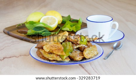 Paparajotes - typical dessert of Murcia, made of lemon leaves covered with dough, sprinkled with powdered sugar and cinnamon - stock photo