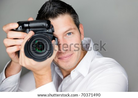 Paparazzi man taking picture with photo camera - stock photo