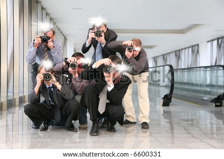paparazzi with flashes - stock photo