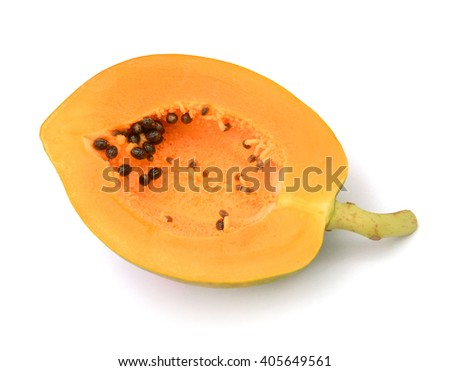 Papaya fruit sliced and leaves isolated on a white background