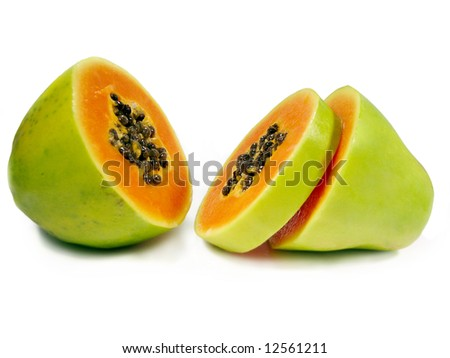 Papaya fruit sliced through the middle isolated on a white background. - stock photo