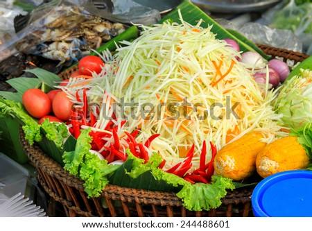 papaya or green ingredients papaya salad on tray, chopped papaya to make papaya salad, papaya fibers were chopped to prepare a salad - stock photo