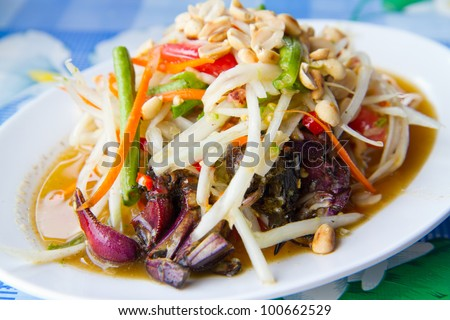 papaya salad with crab on table - stock photo