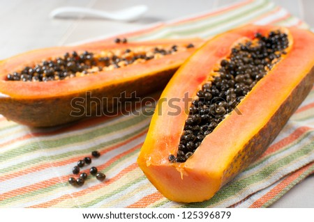 Papaya with seeds ripe and fresh horizontal - stock photo