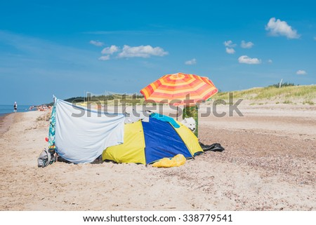 PAPE, LATVIA - AUGUST 09, 2015:  People on the beach waterfront of Baltic Sea in Pape, Latvia.