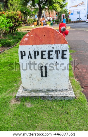 PAPEETE, FRENCH POLYNESIA - JULY 3, 2016 :  A  Zero Kilometer stone on the road in the town of Papeete early in the morning in Tahiti  Papeete, French Polynesia on July 3, 2016