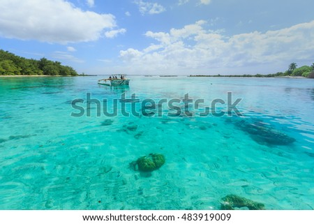 PAPEETE, FRENCH POLYNESIA - SEPTEMBER 12, 2016 : The Beautiful sea and RIB boat in Moorae Island at Tahiti PAPEETE, FRENCH POLYNESIA on September 12, 2016
