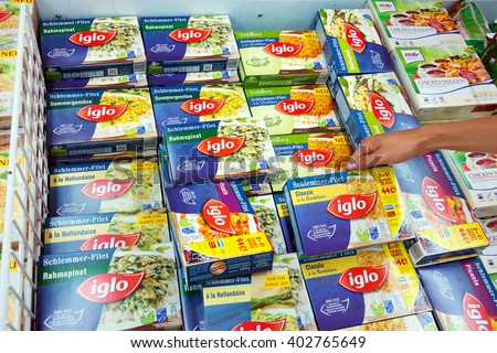 PAPENBURG, GERMANY - AUGUST 11, 2015: Frozen Iglo meals in a Real Hypermarket. Iglo Group is a frozen food company owned by Nomad Foods, a British Virgin Islands-based food company. - stock photo
