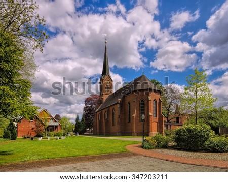 Papenburg, the Nikolaichurch in park - stock photo