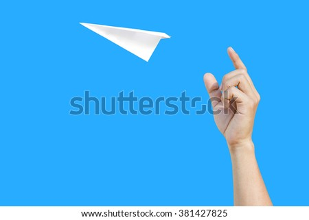 paper aero plane ready to take off as a conceptual picture on blue background
