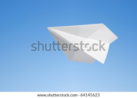 Paper airplane against the blue sky - stock photo