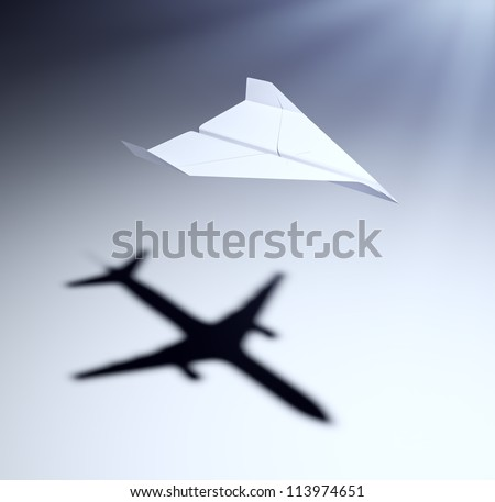 Paper airplane casting a shadow of a jetliner - vision and aspirations concept illustration - stock photo