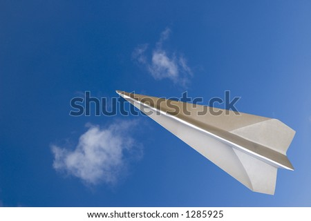 """Paper airplane fly across the top - Contain the """"clipping path"""" for the paperplane to let you select on the plane itself and cut/copy it to your design - stock photo"""