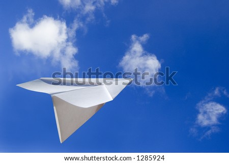 Paper Airplane Flying in the Air - stock photo