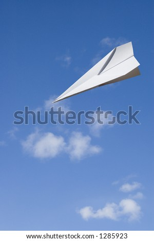 "Paper airplane glide toward the ground and ready to land. - Contain the ""clipping path"" for the paperplane to let you select on the plane itself and cut/copy it to your design - stock photo"