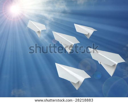 paper airplane in front of blue sky - stock photo