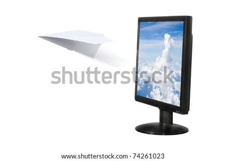 Paper airplane out of the computer screen - stock photo