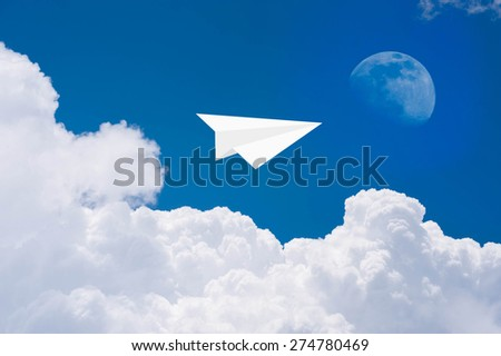 Paper airplanes in blue sky to the moon - stock photo