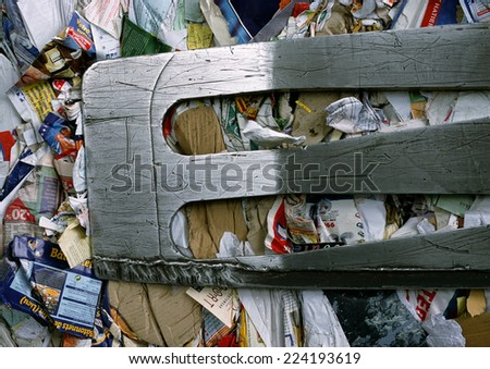 Paper and cardboard being compacted - stock photo
