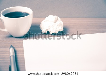 paper and crumpled with pen and coffee cup on wood background vintage style - stock photo