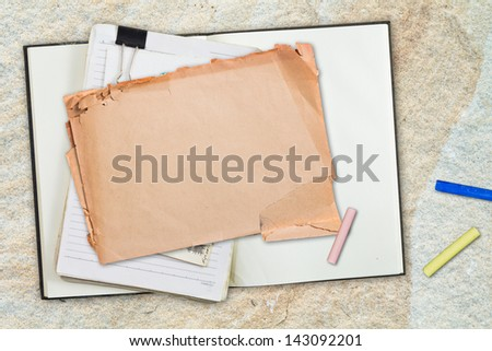 Paper and notebook with color pastel sticks on stone background