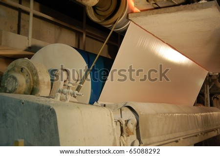Paper and pulp mill. In this plant all the fibrous raw material is produced by two deâ??inking plants that recycle waste paper. 50% of all the plantâ??s energy requirements  is produced autonomously. - stock photo