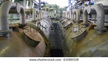 Paper and pulp mill - In this plant all the fibrous raw material is produced by two de-inking plants that recycle waste paper. 50% of all the plantÂ?s energy requirements  is produced autonomously. - stock photo