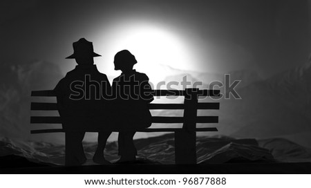 Paper art show lover on the bench watching sunset - stock photo