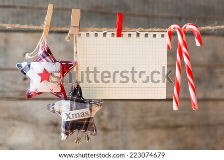 Paper attach to rope. Checkered paper attach to rope, textile stars, christmas candies  - stock photo