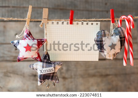 Paper attach to rope. heckered paper attach to rope, Christmas candies, textile heart and stars.  - stock photo