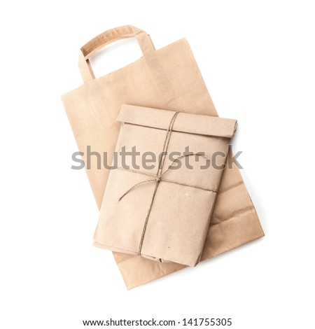 Paper bag and envelope with rope isolated on white background