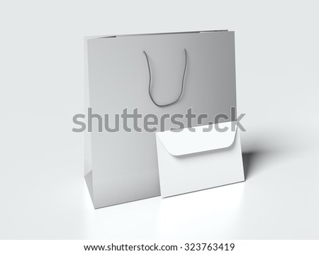 Paper bag and white cardboard sleeve on light background. Mock up