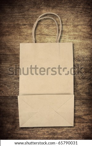 paper bag backside on old wooden background for natural recycle concept