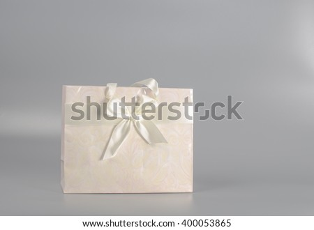 paper bag for gifts and purchases tied ribbon - stock photo
