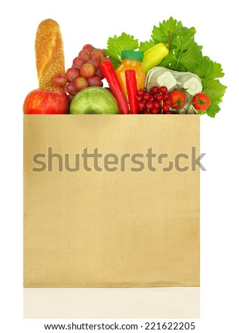 Paper bag full of groceries isolated on white - stock photo